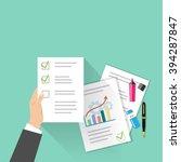 business man's hand holding a... | Shutterstock .eps vector #394287847
