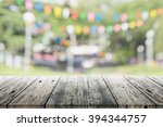 empty wooden table with blurred ... | Shutterstock . vector #394344757