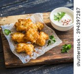 Small photo of Crispy fried fish on a wooden rustic board