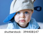 Portrait Of Blue Eyed Baby Wit...
