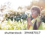 little girl playing with... | Shutterstock . vector #394487017