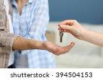 female hand giving keys from...   Shutterstock . vector #394504153