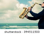 Saxophonist Playing On...