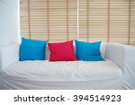 sofa with blue and pink pillows ... | Shutterstock . vector #394514923