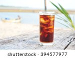 glass of cola with ice  on wood ... | Shutterstock . vector #394577977