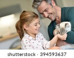Daddy With Little Girl Petting...