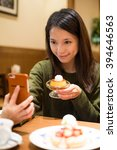 woman take photo with her food...   Shutterstock . vector #394646563