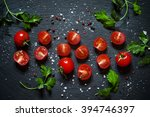 Cut Cherry Tomatoes On A Black...