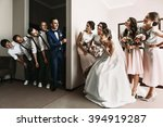 groomsmen   bridesmaids having... | Shutterstock . vector #394919287