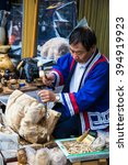 Small photo of Hokkaido Japan - 10 Jul 2014: A skill craft man is carving a symbolic wooden bear at Ainu village, Noboribetsu