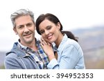 cheerful middle aged couple... | Shutterstock . vector #394952353