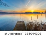 sunrise over beautiful lake in... | Shutterstock . vector #395044303