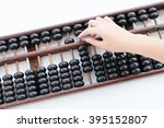 old wooden abacus with fingers | Shutterstock . vector #395152807