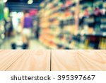 wood table top on blur retro... | Shutterstock . vector #395397667