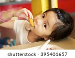 Little Girl Eating Fast Food