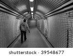 Man Walking Alone Through A...