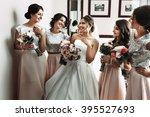 bride   bridesmaids posing with ...   Shutterstock . vector #395527693