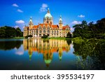 Stock photo new city hall of hannover reflecting in water lower saxony germany 395534197