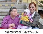 down syndrome woman with baby | Shutterstock . vector #39593026