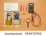 disassembled tablet and tools... | Shutterstock . vector #395970703