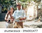 mature couple tourist exploring ...   Shutterstock . vector #396001477