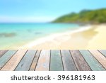 wood table top with blurred... | Shutterstock . vector #396181963