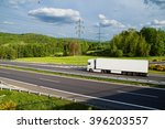 white truck driving on asphalt... | Shutterstock . vector #396203557