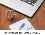 at the table with a cup of... | Shutterstock . vector #396299317