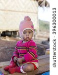Small photo of LOIKAW, MYANMAR - JANUARY 23, 2016: A portrait of a young baby from the Padaung tribe who are famous for wearing large brass coils around their neck but this tradition is rarely practiced anymore.