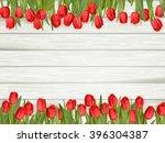 beautiful tulips on wooden...