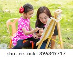 Mother Teach Daughter Painting...
