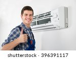 young happy male technician... | Shutterstock . vector #396391117