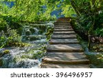 landscape of wooden path along... | Shutterstock . vector #396496957