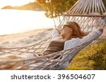 beautiful girl in a hammock on... | Shutterstock . vector #396504607