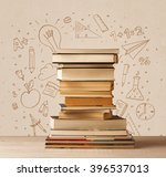 a pile of books on table with