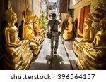 man was walking through golden... | Shutterstock . vector #396564157