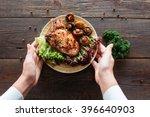 Waiter Serving A Chicken Dish...