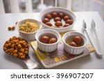 indian dessert dipped in sugar... | Shutterstock . vector #396907207