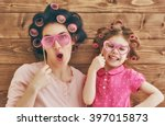 funny family  mother and her... | Shutterstock . vector #397015873