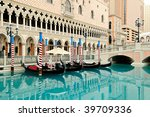 Beautiful picture of Venetian gondolas and blue water - stock photo