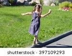 Little Cute Girl Walking On Th...