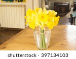 Yellow Daffodils On A Table In...