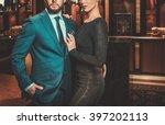 well dressed couple in luxury... | Shutterstock . vector #397202113