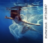 Girl Swims Underwater With A...