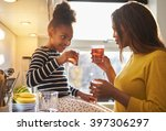 mom and child in kitchen... | Shutterstock . vector #397306297