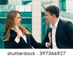 Small photo of Workplace harassment - young business woman stopping aggressive colleague