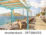 Small photo of Summer photo with panoramic view from Aegina island in Greece. Beautiful place for making lunch on seafront with wooden roof of bar and restaurant. Magic moment during sunny day for chilling and relax