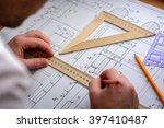 man architect draws a plan ... | Shutterstock . vector #397410487