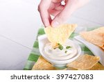 potato chips in a hand dipped... | Shutterstock . vector #397427083