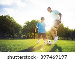 father son playing soccer park... | Shutterstock . vector #397469197